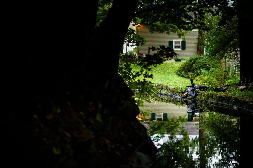 Fun photographer pose inn millrace pond