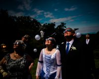 bride and groom watching eclipse with glasses during wedding