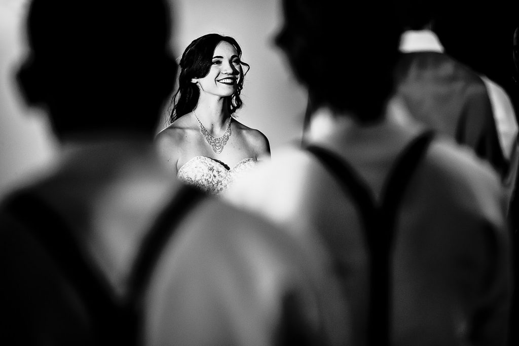 bride laughing during wedding vows