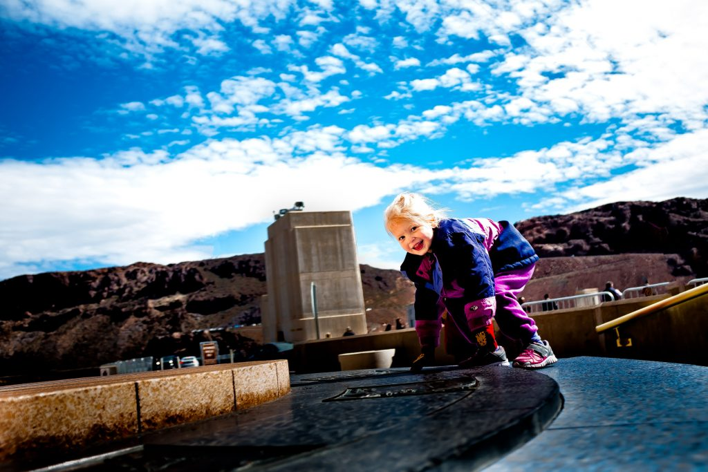 kid playing at the hoover dam