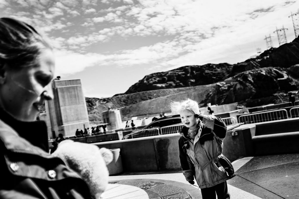kid playing outside the hoover dam