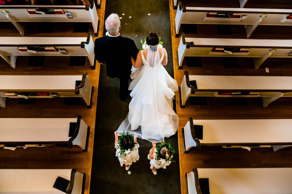 dad and daughter coming down aisle