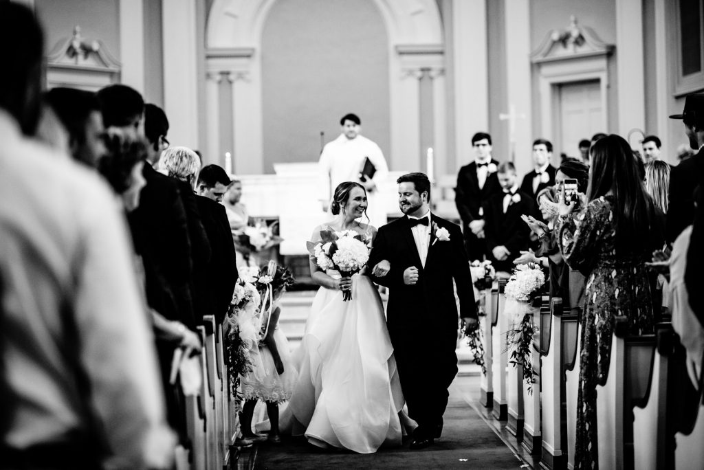 couple leaving wedding